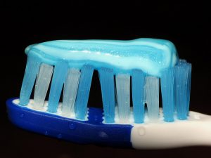 toothbrush with toothpaste for brushing your teeth